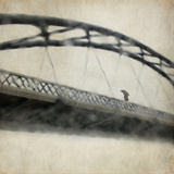 A Man Crossing a Bridge on a Raining Day