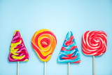 Colorful Vibrant Lollipops  Flat Lay on Blue Background