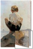 A Boy Crouching on a Rock