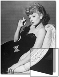 Dancer/Actress Lucille Ball in Strapless Black Lace Evening Dress  Holding Lit Cigarette on Couch