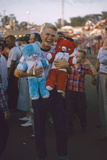 Young Man Holding Stuffed Bears Prizes at a Carnival Game at the Iowa State Fair  1955