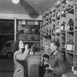 Young Woman Drinking a Bottle of Coca Cola in a Shop  Paris  France  1950