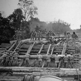 Chinese Engineers Construct a Wooden Bridge by Hand on the Ledo Road  Burma  July 1944