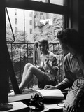 Model Jean Patchet Seated on a Fire Escape  Talks with Eileen Ford  New York  NY  1948