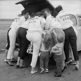"All-Girl ""Dragettes"" Hotrod Club Working on Car Engine with Children  Kansas City  Kansas  1959"