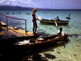 December 1946: Woman and Fishermen at Doctor's Cave Beach in Montego Bay  Jamaica