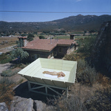 Woman as She Sunbathes Nude in on a Platform with Sides That Allow Privacy  Tecate  Mexico  1961