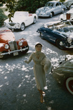 Model in a Dress and Gloves  a Fur over One Arm  and Surrounded by Vintage and Luxury Cars  1954