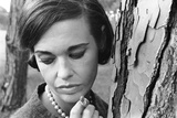 Gloria Vanderbilt Smoking Outside and Showing New Hairdo  1963