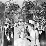 Woman with Her Hair in Permanent Wave Curlers at a Beauty School  1940S