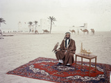 Sheikh Shakhbut Bin Sultan Al Nahyan Sitting in Front of His Palace Holding a Falcon  1963