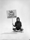 "Studio Photos of Gloria Steinem Sitting on Floor with Sign That Says 'We Shall Overcome""  1965"