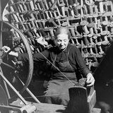 Old Lady at a Time Worn Wheel Winding Strands for Tapestries at Aubusson  France June 1946