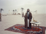 Sheik Shakbut Bin Sultan Al Nahyan Standing in Front of His Palace Holding a Falcon  1963