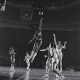 University of Kansas Basketball Player Wilt Chamberlain (C) Playing in a School Game  1957