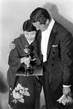 Best Supporting Actress Miyoshi Umeki with Actor John Wayne at the 30th Academy Awards  1958