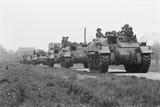 Members of the British 49th Armoured Personnel Carrier Regiment Riding Along a Line of Tanks