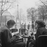 Parisian Couple Drinking Coca Cola at a Sidewalk Cafe While Reading  Paris  France  1950