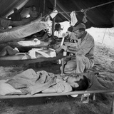 Lew Ayres Treating Wounded Japanese Prisoner in Leyte Cathederal Turned into Hospital  1944
