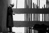 Artist Georgia O'Keeffe Against a Wall Amidst the Shadows of a Fence  Abiquiu  New Mexico  1966