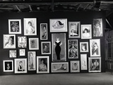 Actress Barbara Rush Posing in a Frame Cut-Out on a Wall Full of Paintings of Herself  1960