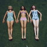 View of Three Unidentified Women in Bathing Suits as They Sunbath on Green Grass  1961