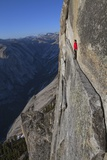 A climber walks a 40-foot-long sliver of granite on Half Dome  named the Thank God Ledge