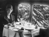 Young Woman Having Breakfast on Board of an Airplane  1928