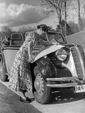 Woman Examining a Road Map on the Hood of Her Bmw 329  1938