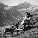 Huntsman with Two Dogs  Ca 1935