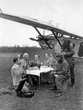 Air Travelers During a Break Next to an Airplane  1930