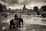 Tourists Travel by Elephant on the Grounds of the Temple  Bayon