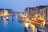 Outdoor Cafes and Gondolas Line Venice's Grand Canal Reflecting City Lights at Dusk