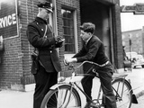 Policeman Controls a Cyclist in America  1938