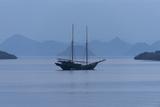 A Pinisi Sailing Vessel Off the Coast of Rinca Island  Komodo National Park  Indonesia
