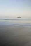 A Ship at Sunrise Along the Coast of Santiago Island  Galapagos Islands  Ecuador