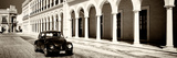 ¡Viva Mexico! Panoramic Collection - Black VW Beetle and Mexican Architecture Sepia