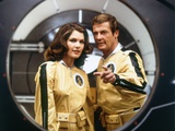 MOONRAKER, 1978 directed by LEWIS GILBERT Lois Chiles / Roger Moore (photo) L' Espion qui m'aimait THE SPY WHO LOVED ME by LewisGilbert with Roger Moore and Barbara Bach, 1977 Roger Moore The Persuaders LIVE AND LET DIE, 1973 directed by GUY HAMILTON Roger Moore (photo) THE MAN WITH THE GOLDEN GUN, 1974 directed by GUY HAMILTON Maud Adams, Roger Moore and Britt Ekland The Persuaders! Live and Let Die, Roger Moore, 1973 Michelin, Tire James Bond