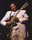 BB King Performing on Stage using Black Les Paul in Grey Suit with White Cuffs and Collar Shirt band shirt