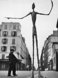 Skeletal Giacometti Sculpture on Parisian Street Papier Photo par Gordon Parks