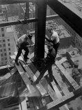 Workmen Attach Steel Beams Above Street During Construction of the Manhattan Company Building Papier Photo par Arthur Gerlach