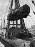 Locomotive Hoisted by Merritt-Chapman-Scott Crane Headed for France to Boost the Postwar Effort