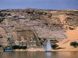 Boats on Nile River Passing Massive Statues of Pharoh Ramses II at Door to Queen Nefertari's Temple