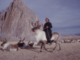Woman Riding One of Her Reindeer in Outer Mongolia