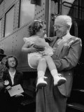 Harry Truman Holding up 3 Yr Old Suzanne Bump after the Town's Postmaster Pressed Her into Service