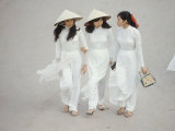 Three Vietnamese Young Women in White Fashion Walking Down the Street