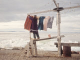 Alaskan Woman Hanging Her Laundry to Dry Along the Edge of an Ice Sheet