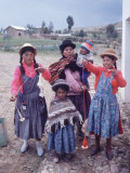 Mother and Four Children Wearing Derby Hats  Playing with Ball of Yarn  Andean Highlands of Bolivia