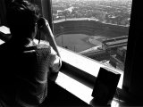 Pittsburgh Pirate Fan Atop University's Cathedral Looking Down at World Series Baseball Game