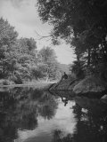 Man Sitting on the Bank of the Upper Opalescent River  a Branch of the Hudson